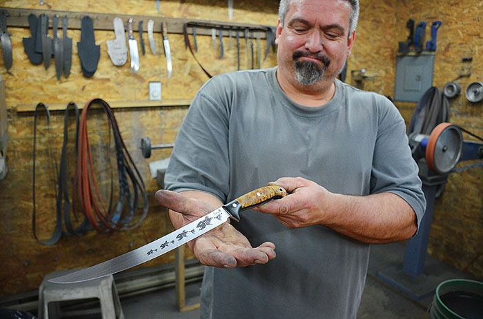 Custom Knife maker Scott Laughlin with one of his beautiful custom knives.