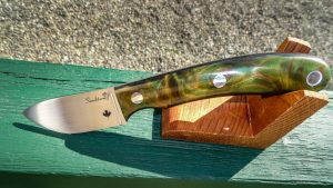 A beautiful Sandstorm custom knife with a green handle.