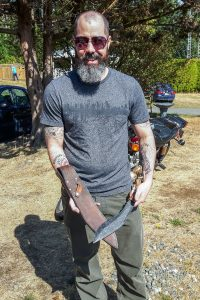 A man with a beard shows off his Sandstorm Custom Kukri Knife.